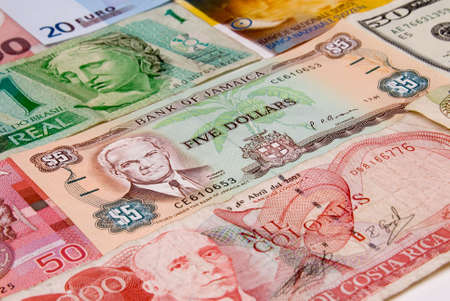 assorted international paper money close up photo