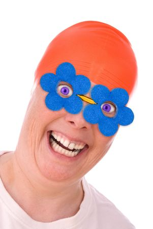 Woman with an orange swim cap and blue spring flower eye glasses making a funny face isolated over white Stock Photo - 2123708