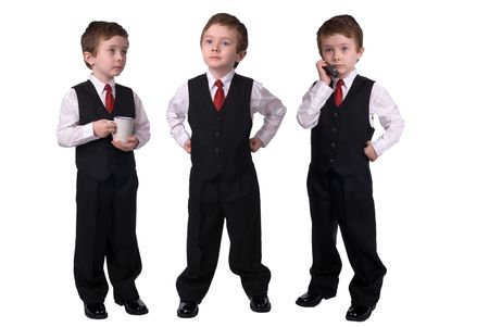 children talking: Handsome attractive young boys dressed in suits with a cell phone and coffee cup in hand on white background.