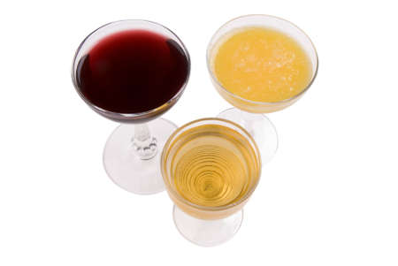 three wine glasses with wine,orange juice and apple juice photo