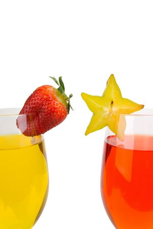 garish: orange and yellow cocktails with a star fruit and strawberry garish isolated on white