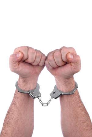 object oppression: two hands in handcuffs isolated over white
