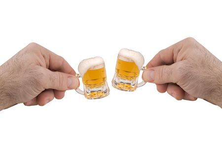 Mini Mugs of beer with froth isolated over white photo