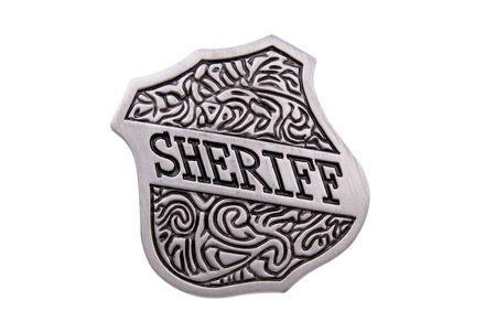 Vintage toy sheriffs badge over white photo