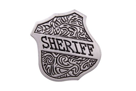 deputy sheriff: Vintage toy sheriffs badge over white