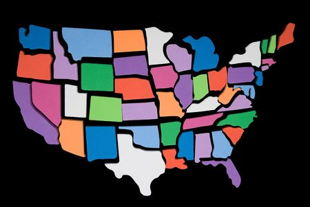 textured USA map puzzle outline over a black background Фото со стока