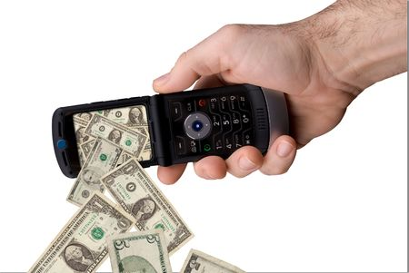 mans hand holding modern cell phone with money spilling out of the screen isolated over white Banco de Imagens