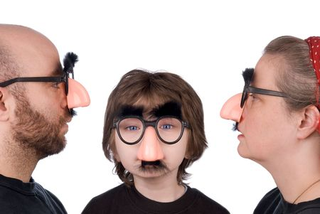 trickster:  of three wearing fake nose and glasses with mustashe and eyebrows over a white background