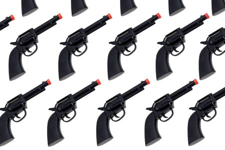 Black Toy hand guns with red tip isolated over white Imagens
