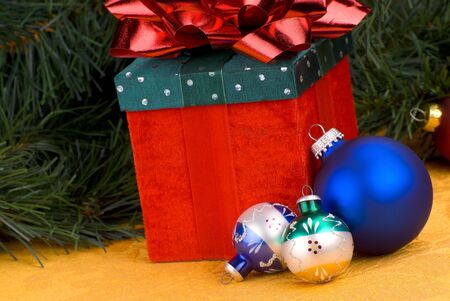 Christmas balls with a present,red beads and pine branch Stock Photo