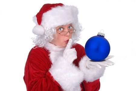 Mrs. Claus with a Christmas ball in her hand isolated over white Imagens