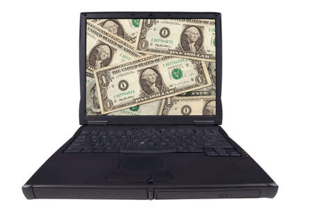 laptop computer with American paper money on the screen isolated on a white background photo