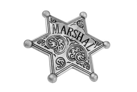 Vintage toy Marshal badge over white  Stock Photo