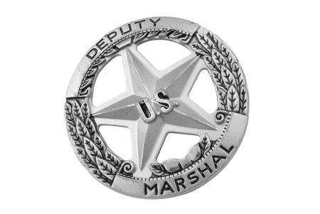 Vintage toy U.S. Deputy marshal badge over white