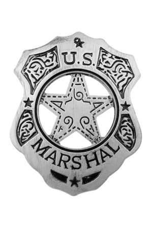 Vintage toy U.S. marshal badge over white