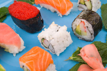 A selection of sushi on a blue plate Stock Photo