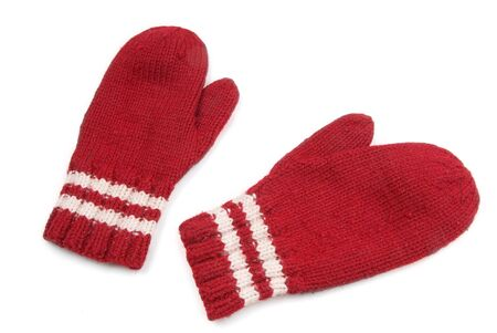 Red mittens with white stripe on wrist over white