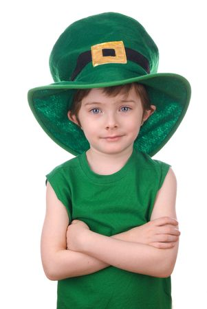Happy young leprechaun boy wearing a humorous Saint Patricks Day hat.