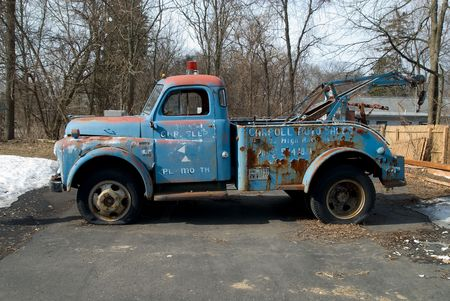 an old grungy 1960s tow truck