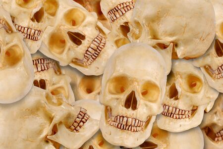 brainpan: plastic skulls piled together one ontop of each other