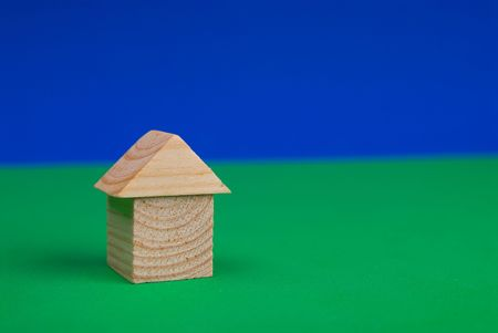 Wood toy block house on the blue and green background Stock Photo - 2133823
