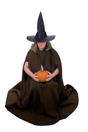 Female witch holding a pumpkin isolated over white Stock Photo - 2133835