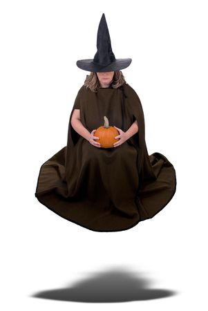 Female witch holding a pumpkin and floating isolated over white Stock Photo - 2133820