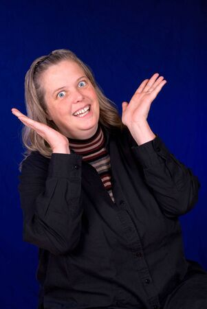 Middle aged Surprised woman over a blue gradient background Stock Photo - 2133867