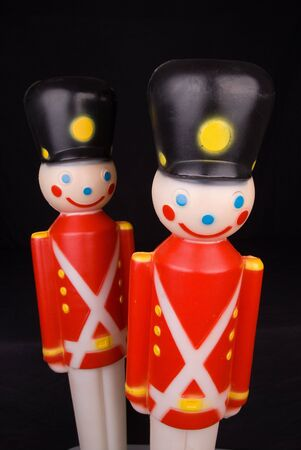 vintage plastic toy christmas soldiers over black photo