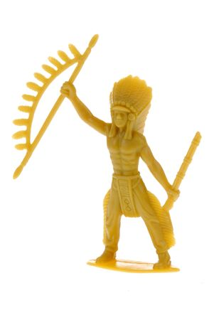 plains indian: yellow plastic toy American Indian chief isolated over white