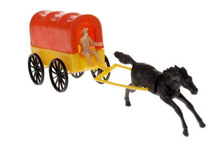 covered wagon: plastic toy frontier covered wagon with horse isolated over white Stock Photo