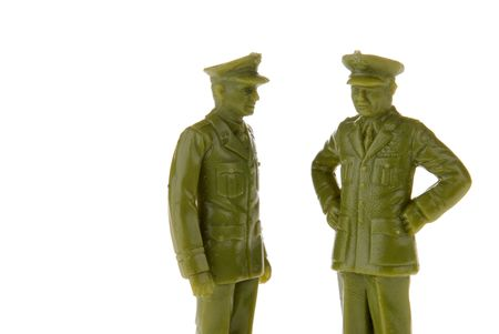 green plastic soldiers: plastic toy army officers or Generals isolated over white
