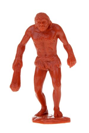 cave dweller: plastic caveman toy isolated over a white background Stock Photo