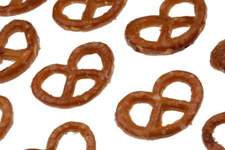 pretzel: Pretzels laid diagonally isolated over a white background Stock Photo