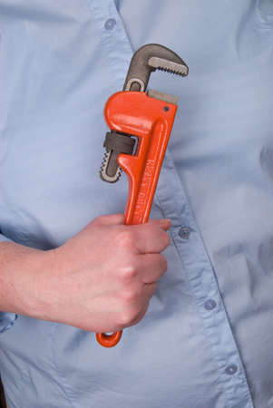 Woman hand holding a wrench  photo