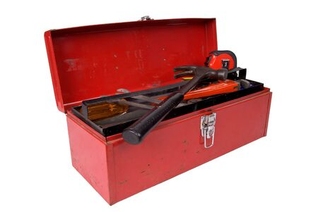 toolbox: Old used and rusty tools in a red toolbox over a white background