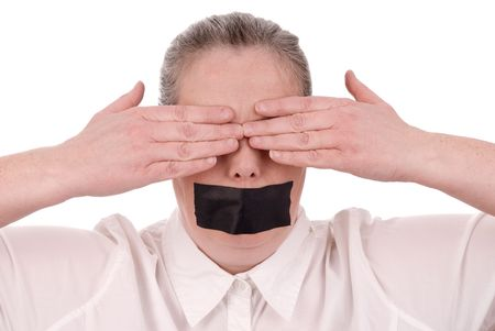 shutup: Woman with mouth taped and hands over her eyes closed over a white background