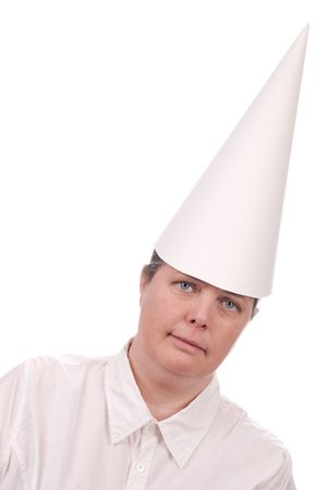 Woman in a dunce cap with eyes open over a white background photo
