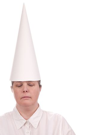 Woman in a dunce cap with eyes closed over a white background photo
