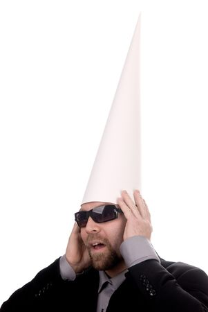 dunce cap: Man in a dunce  cap with sunglasses over a white background