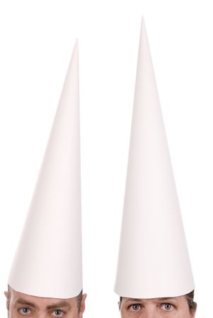 embarrassment: Man and woman in dunce caps over a white background Stock Photo