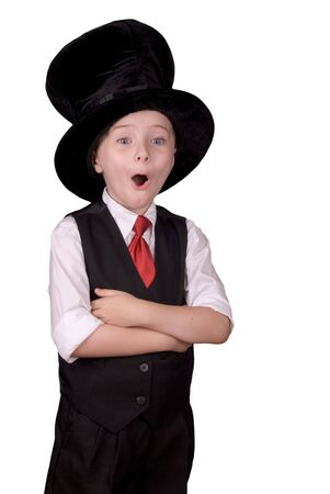 Young boy dressed as a magician with a hat and a surprised expression over a white background Imagens