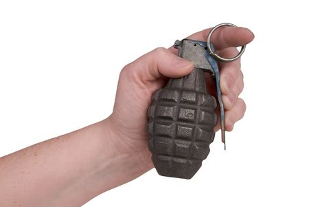 Hand grenade in a womans hand isolated over a white background