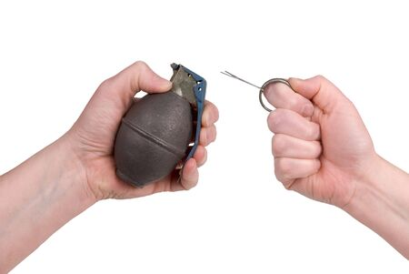 Hand grenade in a womans hand with the pin pulled isolated over a white background