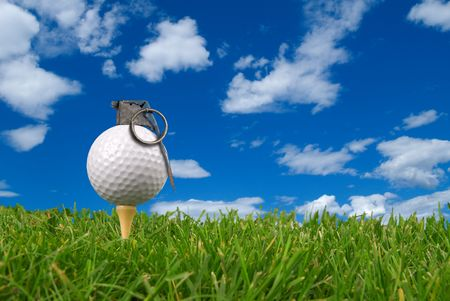 frag: Golf ball grenade from the ground level with grass and cloudy sky
