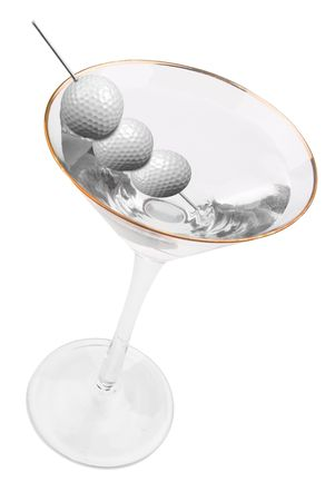 martini with golf ball olives isolated on white background