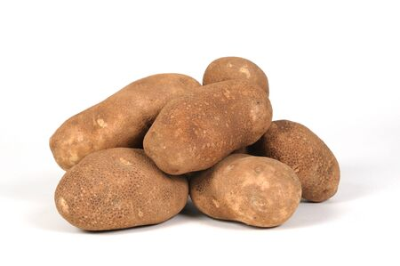 russet: Potatoes in a pile over a white background Stock Photo