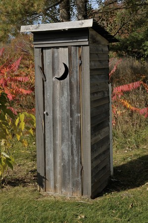 latrine: Outhouse with a moon shaped window in the woods