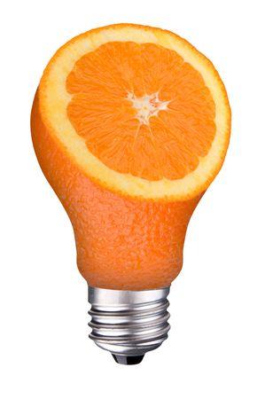 incandescent lightbulb with orange slice inside isolated over white