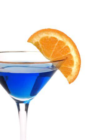garish: Blue cocktail with an orange garish isolated on white Stock Photo